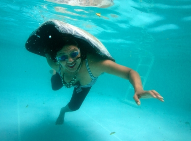 Underwater of Ursula Raymond - of Torres Strait origin with turtle shell in her pool
