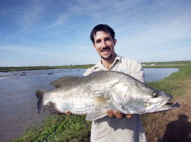 Dan Richards with barramundi at the Humpty Doo barramundi farm, outside Darwin, NT. fish marine aquatic life recreation