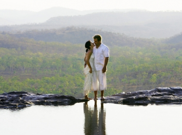 The wedding of Tanya and Craig at Gunlom in Kakadu National Park, northern Australia. outdoors wedding tropical marriage ceremony waterhole outback 567985 Photographer: David Hancock. Copyright: SkyScans