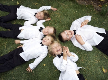 Page boys enjoy themselves at a wedding