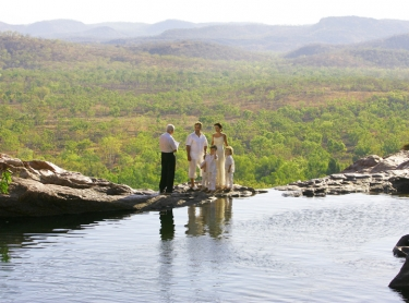 The wedding of Tanya and Craig at Gunlom in Kakadu National Park, northern Australia. outdoors wedding tropical marriage ceremony waterhole outback 567867 Photographer: David Hancock. Copyright: SkyScans