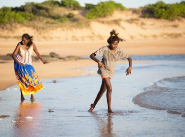 Yolngu women - grandmother Doris Yethun Dahmbing Burarrwanga, daughter Abby Dhamarrandji (23) and grand daughters Grace Bururrwanga (12) and Rekisha Gaykamaangu (3) walk along the beach at NGayawili, on Elcho Island