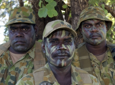Soldiers of Norforce, who protect and observe Australia's northern coastline patrol in remote bushland. Many of the soldiers are Aboriginal. indigenous military L to R: Elijah Apurryarnk, Pte Leonard Lamilami, Pte Allen Gebadi, of Goulburn Island