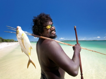 Bawaka tourist area near Port Bradshaw in north eastern Arnhem Land. Traditional landowner Timmy Burarrwanga and other aboriginal men fishing in pristine waters