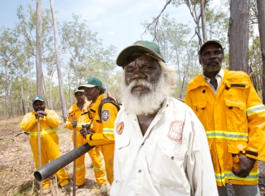 Warddeken Indigenous Protected Area covers 1,394,951 hectares of spectacular stone and gorge country on the western Arnhem Land plateau, in northern Australia. The area adjoins Kakadu NP. Fire management - rangers using rakes and leaf blowers