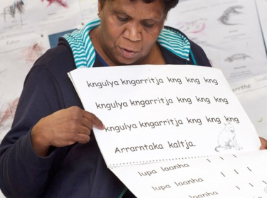 Efforts to revive and strengthen indigenous language in central australia ivolve linguists, missionary groups and traditional aboriginal women. Mona Kantawara teaches from an Arrente phrase book at the Hermannsburg School, west of Alice Springs