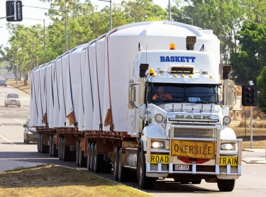Plastic water tanks manufactured by Terracorp in Darwin are loaded for transport to pastoral station.