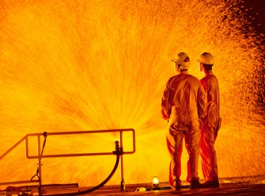 Flaring on an oil rig in the Timor Sea - water is sprayed over superstructure