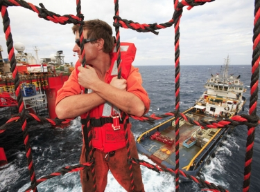 The Stena Clyde drilling rig at the Puffin 7 hole. Oil energy offshore exploration industry. Roustabout Patrick van Lieshout rides a Billy Pugh between rig & tender. marine supply boat. health safety 580 Photographer: David Hancock. Copyright: SkyScans