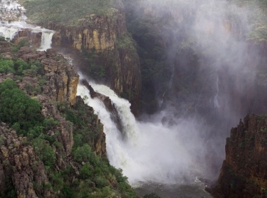Kakadu National Park in the Top End of northern Australia is one of the world's Heritage areas and a popular destination for tourists from all over the world. Arnhem Land escarpment in the wet season - Twin Falls