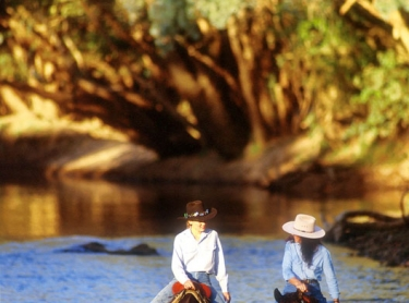 Ayla Hunt and Su Lamb walk their horses through the shallows of the Katherine River downstream of the Katherine Gorge. Photographer:David Hancock/Copyright:SkyScans