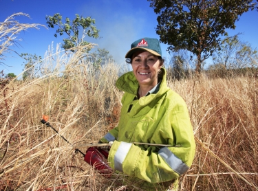Bushfires NT - Sue Lamb lights a controlled fire during a dry season burn-off.
