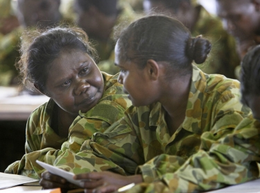Norforce recruits examine their assessments after the passing out parade at Kangaroo Flats Training Centre, south of Darwin. Photographer: David Hancock. Copyright: SkyScans