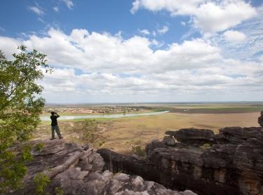 Venture North tourism on Cobourg Peninsula and through Arnhem Land. The tour takes visitors to the Garik Gunak Barlu national park, Oenpelli rock art sites at Karnbalunya and Mamukala in Kakadu NP. escarpment near Karnbarlunyah (Oenpelli) - looking to township across floodplain - Aboriginal guide Joey Nganjmirra