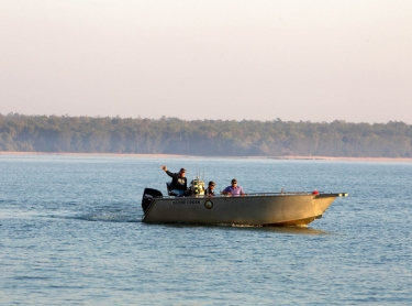 Fishing at Goose Creek on Melville Island, from Melville Island Lodge, Tiwi Adventures. Milikapiti community art centre Tiwi College