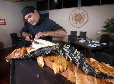 Nitmiluk NP - Cicada Lodge tourism resort - tourism destination - indigenous chef Mark Olive cooks main meal of crocodile tail